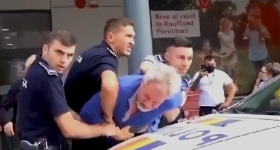 VIDEO. Pensionar încătușat de trei echipaje de poliție după ce a refuzat termoscanarea și a devenit recalcitrant