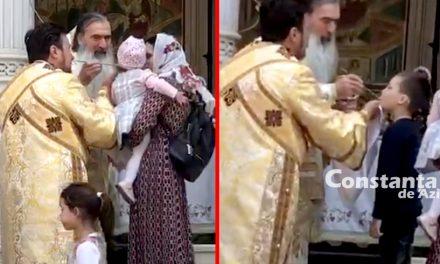 VIDEO. Pericol public! Teodosie a împărtăşit copii cu aceeaşi linguriţă, preoţii au împărţit pască din acelaşi bol