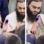 VIDEO. Înghesuială la pupatul Evangheliei. ÎPS Teodosie încurajează gestul, în timp ce la Constanța sunt raportate noi decese cauzate de COVID