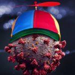 Bravii cercetători ruși au descoperit că virusul folosește o șepcuță cu elice pentru a circula prin aer
